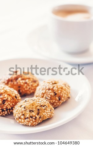 Morning coffee with sesame cookies (shallow dof)