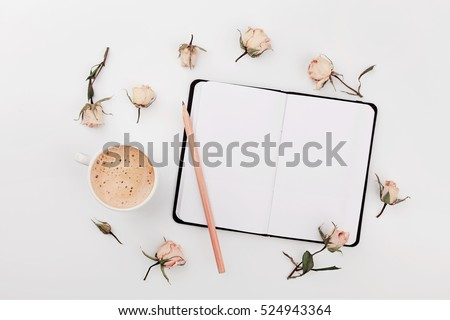 Morning Cup of coffee, empty notebook and dry roses flowers on white table from above. Cozy Breakfast. Flat lay style. #524943364