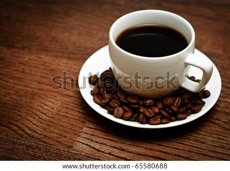 morning cup of coffee on a wooden table