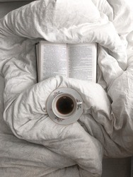 morning cup of tea on the bed, book