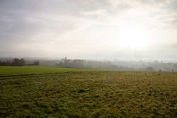 Morning dawn on fields in old European town with beautiful nature during sunrise