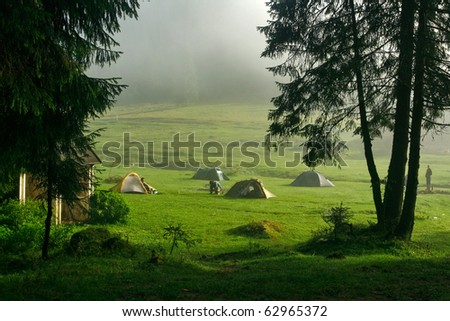 Morning dew and tents in the mountain camp site