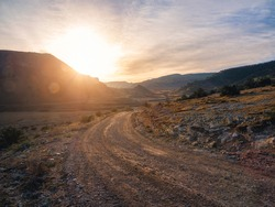 Morning dirt road through the mountain plateau.