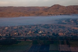 Morning fog above Luxor, view from a hot air balloon at sunrise, Luxor, Egypt