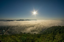 Morning fog covers Lamphun, Thailand, view from the viewpoint of Wat Phra That Pha Temple