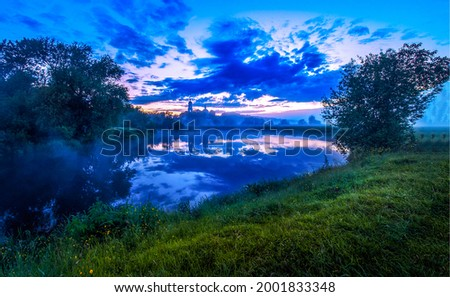 Morning fog over the river at dawn. Early morning river at dawn. Early morning fog on the river at dawn
