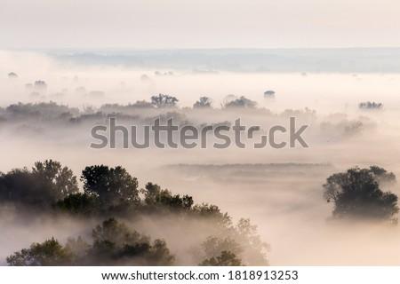 Morning foggy valley at sunrise, calm autumn landscape near Zmiiv,  Kharkiv region, Ukraine Zdjęcia stock ©