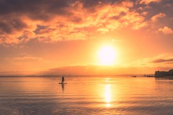 Morning glory over Swan river with man stand up paddle boat silhouette