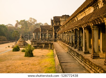 Morning in Angkor Wat. The Angkor Wat is a temple complex in Cambodia and the largest religious monument in the world.