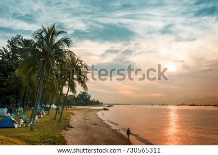 Morning in East coast beach Singapore  #730565311