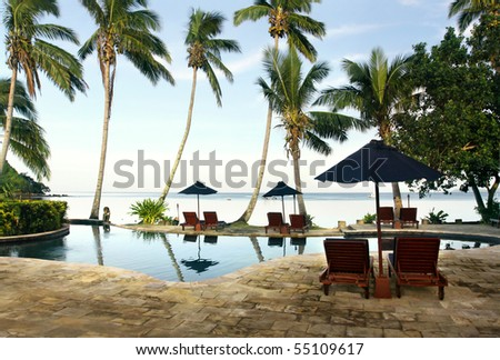 Morning in tropical paradise. View to swimming pool and sea - stock photo