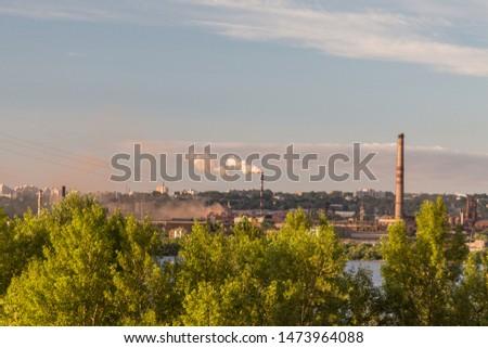 Morning, industrial landscape, industrial enterprise on the river bank