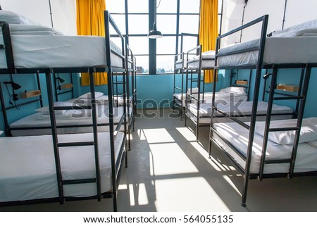 Morning inside the hostel bedroom with clean white beds for students and lonely young tourists Сток-фото ©