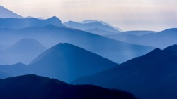 Morning landscape in various shades of blue tones in the mountains, Hautes-Alpes, France