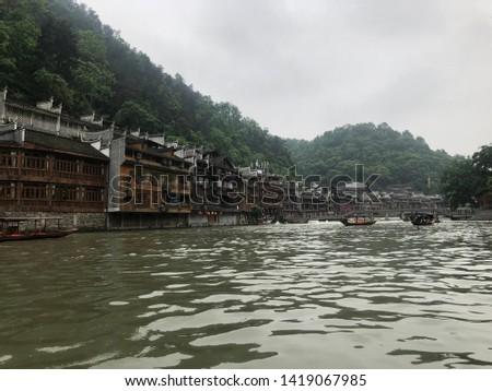 Morning life at Huang Ancient Town (Phoenix Ancient Town) on Tuo Jiang River, Hunan Province, China
