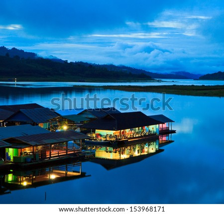 Morning light at Waterfront home and Home in the water and raft in Sangklaburi kanchanaburi Province Asai Thailand
