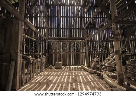 Morning Light. Morning sunlight illuminates the interior of a barn. This is a barn open to the public on national park lands, it is not a privately owned property. #1294974793
