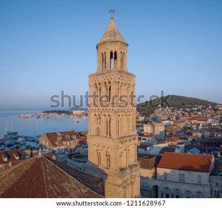 Morning light over the city of Split, Croatia, illuminates the bell tower of cathedral of St Dominus. Panoramic picture showing the old town, looking out over the Brac channel and the Adriatic coast.