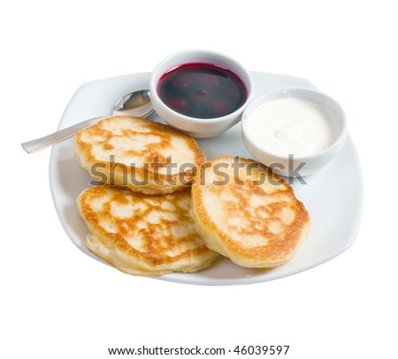 morning meal.pancakes with sour cream and jam