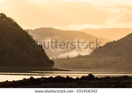 Morning mist at sunrise in the highlands of Scotland