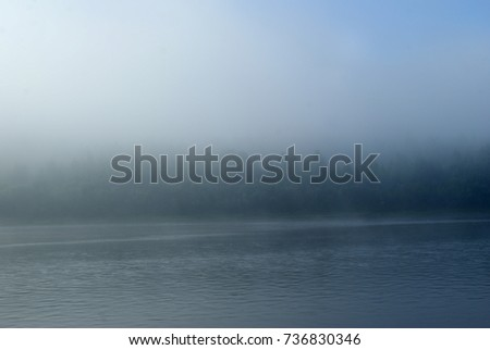 Stock Photo Morning mist over the Ural river Vishera. View across the river to the opposite shore, lost in the fog