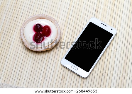 Morning Mood, where on a light table is a phone with Cake