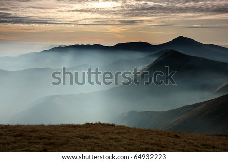 Morning mountain landscape with waves of fog