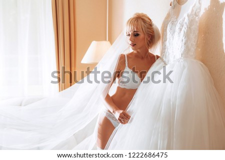8426fc96f59b morning of the bride. bride in luxurious underwear in anticipation of the upcoming  event #