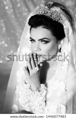 Morning of the bride. Wedding. Beautiful Bride Portrait wedding makeup hairstyle, gorgeous young woman in white dress at home. Black and white. Black and white. #1446077483