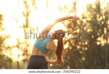 Morning of young sporty woman training in park - Shutterstock ID 706390222