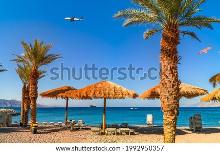 Morning on sandy beach in Eilat - famous tourist resort and recreation city in Israel