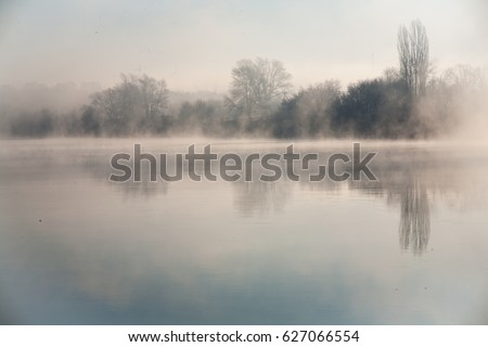 Morning on the river early morning reeds mist fog and water surface on the river #627066554