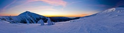 Morning panorama of Krkonose mountains with Snezka, national park at dawn in winter
