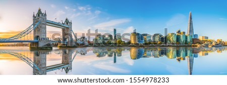 Morning panorama of London Tower Bridge with reflection