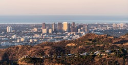 Morning panorama view of Century City and Beverly Hills with the Pacific Ocean in background.  Shot from mountaintop near popular Griffith Park in Los Angeles, California.
