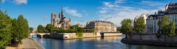 Morning panoramic view of Notre Dame de Paris cathedral and banks of the Seine River. Ile de la Cite, Ile Saint-Louis, Paris, France
