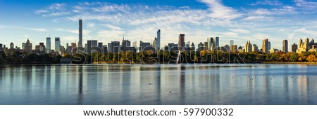 Morning panoramic view of the Central Park Reservoir and Midtown Manhattan skyscrapers in Fall. New York City #597900332