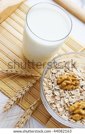 Morning porridge, nuts, wheat and glass of milk