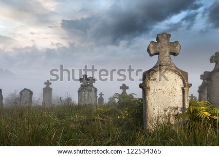 Morning quarters of some very old tombstones in a very old abandoned cemetery in Hungary. It was a stormy day