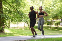Morning Run. Sporty Black Guy And Girl Jogging Together In Green Park, Full-Length Shot With Free Space
