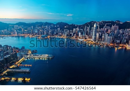 Morning scenery of Hong Kong & Kowloon before sunrise with city skyline of crowded skyscrapers by Victoria Harbour & ships between Tsim Sha Tsui & Central Ferry Piers ~ Beautiful cityscape of Hongkong