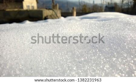 morning snow glistening in the sun.