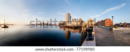 Morning sun lights up Boston Harbor and the downtown waterfront. Taken from the end of Long Wharf - stock photo