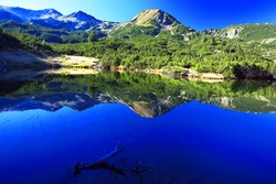 morning sunlight and peak reflection on the lake