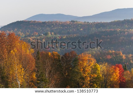 Morning sunrise during fall foliage season, Stowe, Vermont, USA