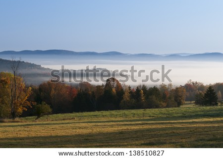 Morning sunrise during fall foliage season, Stowe, Vermont, USA