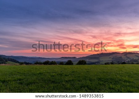 Morning sunrise in Beskyd area colored dark sky with clouds and fresh fog covering grass around mountains and hills behind in the valley. #1489353815