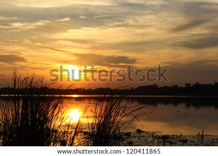 morning sunrise over Laos at left side of Khong river as shot from Thailand