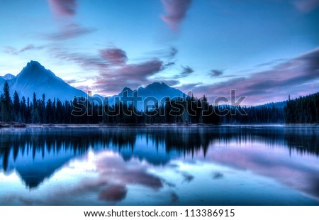 Morning sunrise over Spillway Lake in Kananaskis Country, Alberta, Canada.