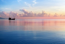 Morning sunrise pink sky, blue sea, white clouds, ship silhouette, scenery landscape, soft color sunset on ocean coast, beautiful seascape, boat and sun reflection on water, Thailand, Koh Samui island